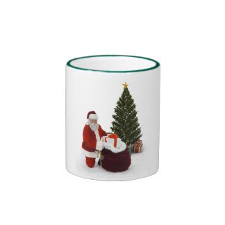 Santa setting presents by the tree coffee mug