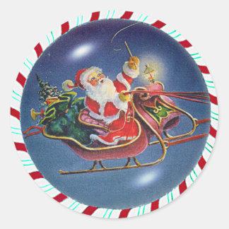 SANTA, SLEIGH & CANDY CANE WREATH by SHARON SHARPE Classic Round Sticker