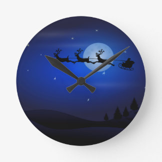 Santa, Sleigh, Reindeer, and Moonlit Landscape Round Wall Clock