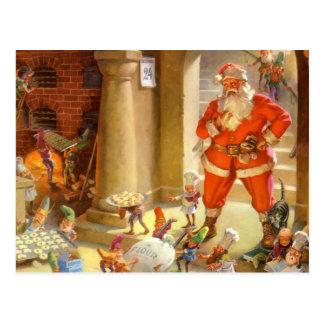 Santa supervisa sus duendes el cocer de la galleta tarjeta postal