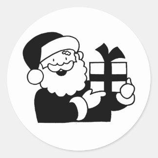 Santa With a Present Classic Round Sticker