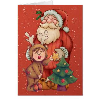 Santa With Cute Little Raindeer Boy And Christmas Card