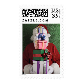 Santa with stack of gifts postage