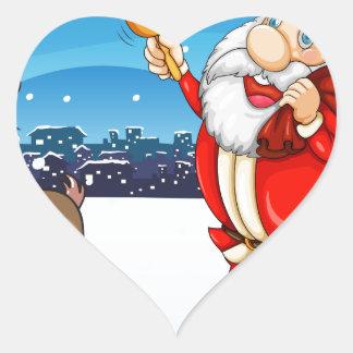 Santa y el su caminar de los ciervos pegatina en forma de corazón