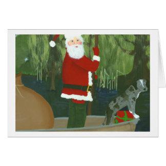 Santa y Houla en tarjeta de Navidad de la piragua