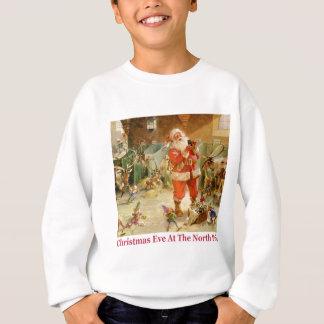 Santa y los duendes en los establos de Polo Norte