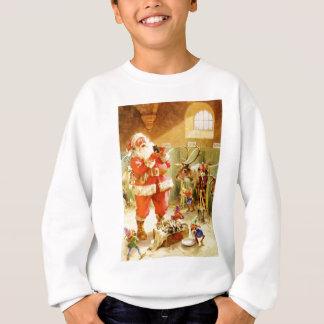 Santa y los duendes en sus establos de Polo Norte