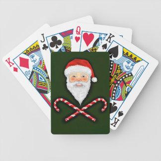 Santa y naipes cruzados de los bastones baraja cartas de poker