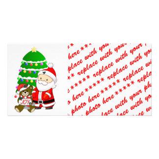 Santa y oso del navidad tarjetas fotograficas