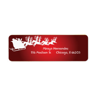 Santa y reno en etiquetas de una dirección del etiqueta de remite
