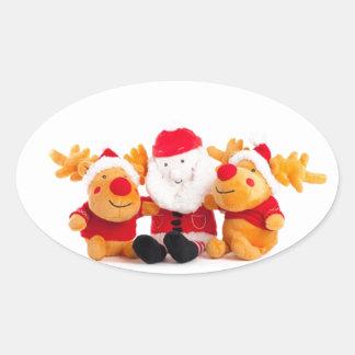 Santa y renos pegatina ovalada