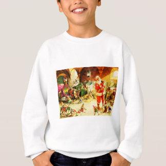 Santa y sus duendes en los establos de Polo Norte