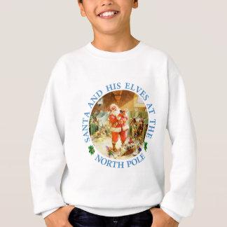 Santa y sus duendes en sus establos de Polo Norte