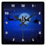 Santa y sus renos que vuelan en la noche relojes de pared