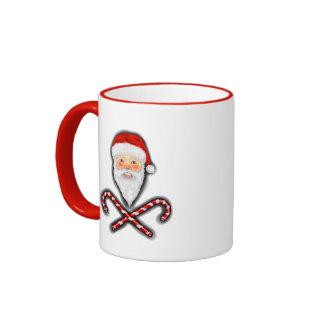 Santa y taza cruzada de los bastones