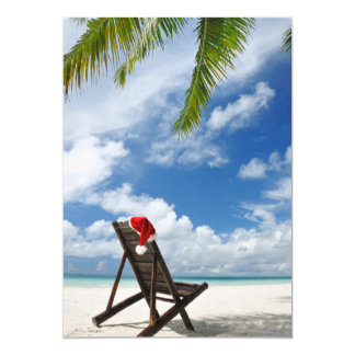 Santa's hat and chaise lounge on the beach card