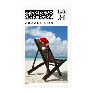 Santa's hat and chaise lounge on the beach postage