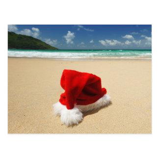 Santa's hat on a tropical beach postcard