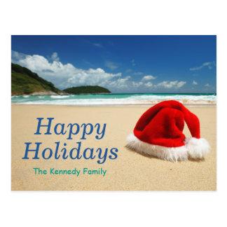 Santa's hat on beach postcard