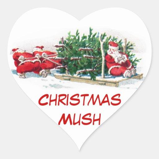 Santas que tiran de Navidad divertida del trineo Pegatina En Forma De Corazón