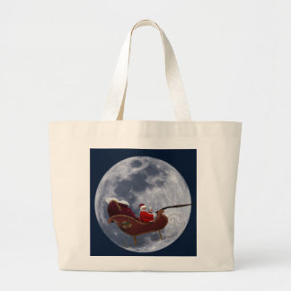 Santa's Sleigh Flying by the Moon Canvas Bags