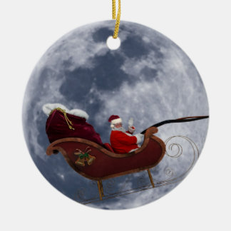 Santa's Sleigh Flying in Front of Moon Double-Sided Ceramic Round Christmas Ornament