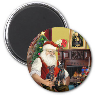 Santa's Two Miniature Pinschers. 2 Inch Round Magnet