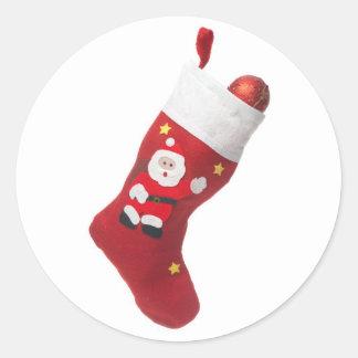 Santa's white and red stocking classic round sticker