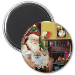Santa'sTwo Pomeranians 2 Inch Round Magnet
