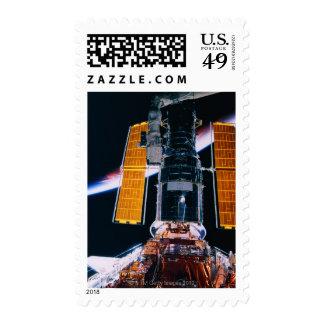 Satélite que lanza de transbordador espacial sello