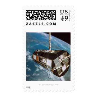 Satellite above Earth Postage Stamp