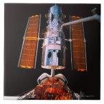 Satellite Docked on Space Shuttle Ceramic Tile