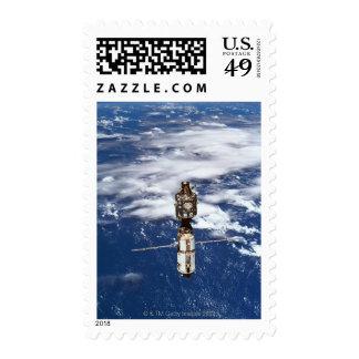 Satellite Orbiting Earth 4 Postage Stamp