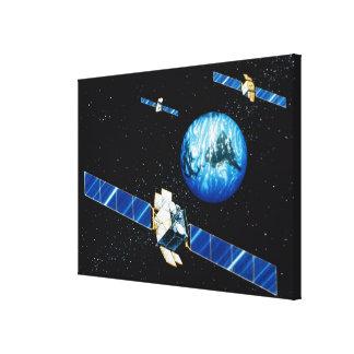 Satellite orbiting earth canvas print