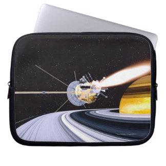 Satellite orbiting Saturn Laptop Sleeves