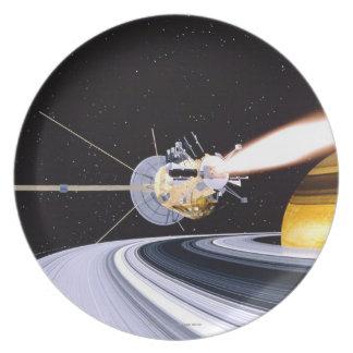 Satellite orbiting Saturn Melamine Plate