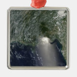 Satellite view of an oil spill metal ornament
