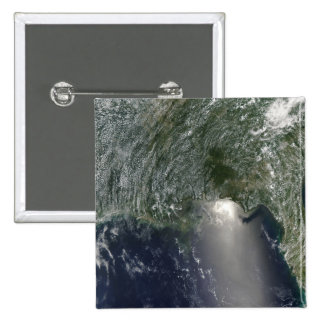 Satellite view of an oil spill pinback button