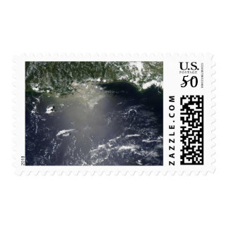 Satellite view of oil leaking postage