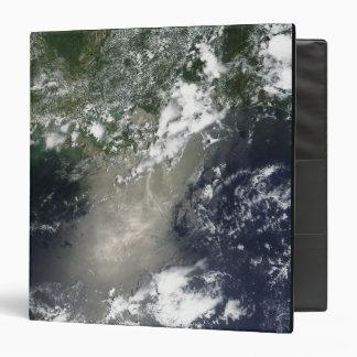 Satellite view of streaks and ribbons of oil binder