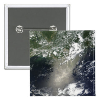 Satellite view of streaks and ribbons of oil buttons