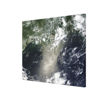 Satellite view of streaks and ribbons of oil canvas print