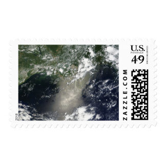 Satellite view of streaks and ribbons of oil postage