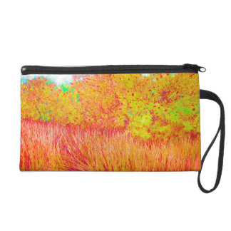 Saturated grass tree florida background wristlet clutch