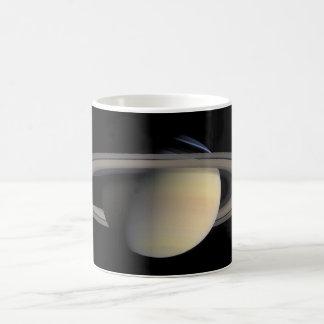 Saturn planet with rings around it coffee mug