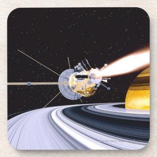 Saturn que está en órbita por satélite posavasos de bebidas