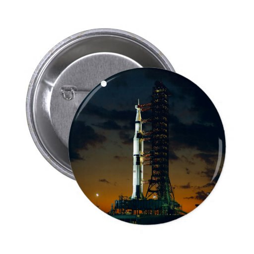 Saturn V rocket on the launch pad Button
