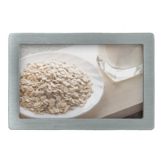 Saucer of cereal and a glass of milk in the backli rectangular belt buckle