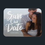 """Save Our Date Announcement Magnet<br><div class=""""desc"""">Modern save the date design featuring the words &quot;save our date&quot; in a brushed white,  handwritten script with a photo of the happy couple displayed behind. White overlay and wedding details can be positioned anywhere on the card.</div>"""
