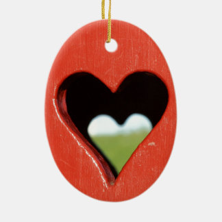 sawn out heart at red Holzwand Ceramic Ornament